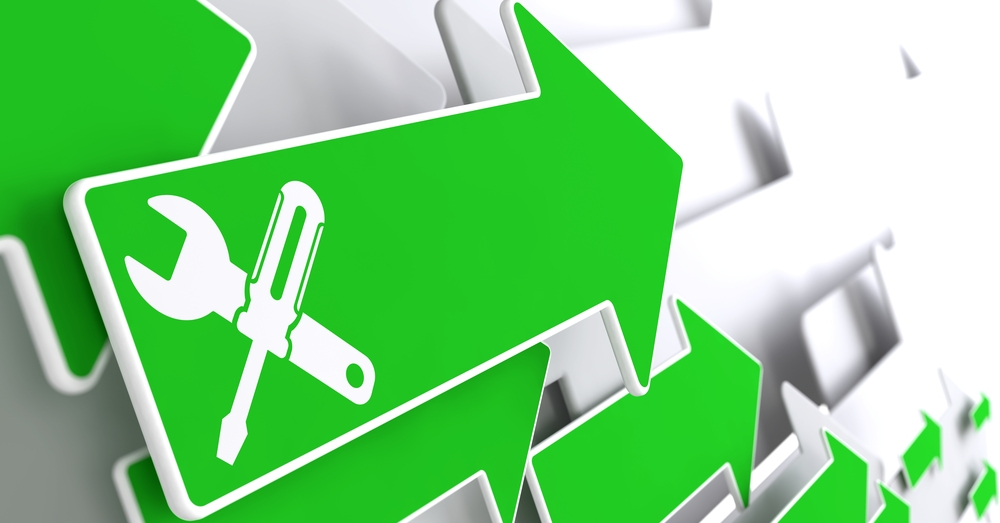 Service Concept - Icon of Crossed Screwdriver and Wrench on Green Arrow on a Grey Background.